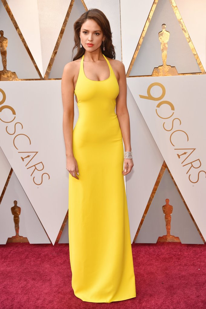 Yellow dresses on red carpet
