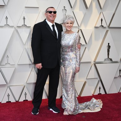 Graham King and guest on the Oscars Red Carpet 2019