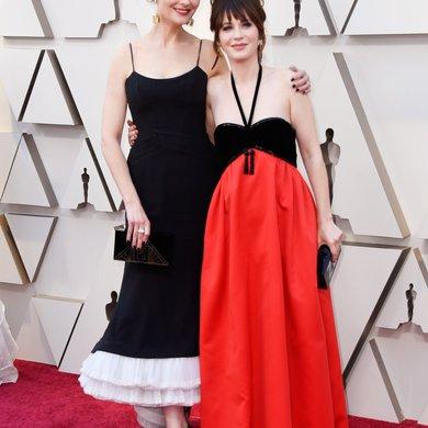 Emily Deschanel and Zooey Deschanel on the Oscars Red Carpet 2019